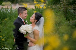Bride and groom celebrate their wedding in nature preserve