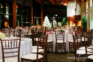 Tables are set in Audubon Hall for holiday party